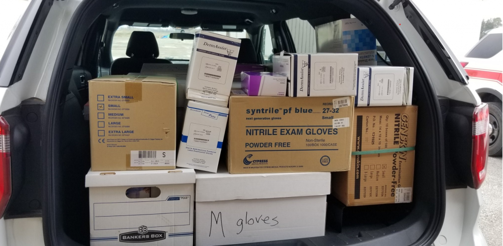 Boxes of the donations are stacked in van.